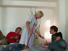 Old cleaning woman takes two hard cocks