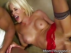 Mature blonde and two black cocks in her hot holes