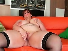 Curvy granny with extra cushion in the right places