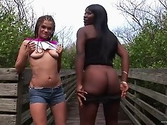 Two hot girls strip outside and lick each other's nipples