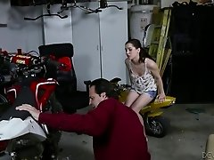 Things get wild as she gets her hairy pussy fucked in a garage