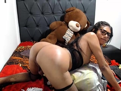 Nerdy Latina shemale in stockings gets fucked in the ass