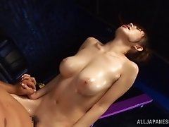 Japanese skank enjoys massage and gets fucked by two men in MMF video