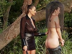 Captivating babes in bondage getting her ass spanked in femdom sex outdoor