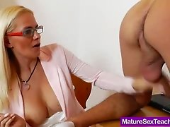 Experty handjob from a busty milf in nerdy glasses
