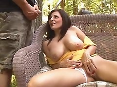 Exquisite brunette milf getting pounded doggystyle after giving a blowjob outdoors
