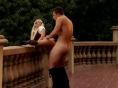 Blonde babe Jesse Jane bent over the balcony rail and reamed