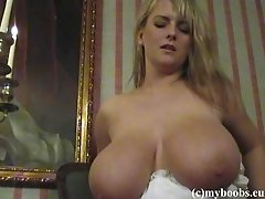 Blond milf Bea Flora strips and shows her enormous boobs