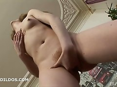 Small tit model masturbates in a close up shoot