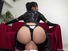 Shiny black latex babe licks his ass and strokes his cock