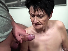 Mature short haired granny Anastasia gets cum on her saggy tits