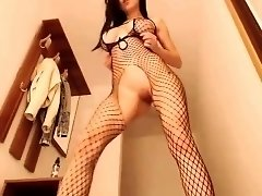 Buxom brunette camgirl in fishnets works her cunt on a dildo