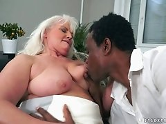 Chocolate guy provides the horny cougar with his large dick