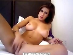 Brunette girlfriend playing with dildo on cam