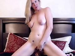 blue eyed blonde milf bangs pussy with bbc dildo