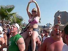 Amateur bitches wearing bikinis flash their tits on a beach