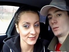 Pretty brunette Nicky gives hand to Markus in a car