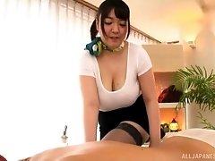 Mochida Yukari oils up her huge boobs and gives a titjob