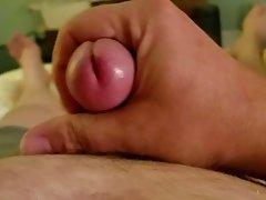 Stroking hard cock