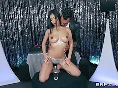 Asian busty beauty Jade Kush gets cum on her oily tits