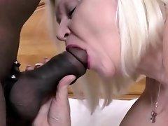 BBW granny with extreme boobs handling fat black rod