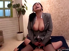 Japanese secretary teases with her big ass before riding cock