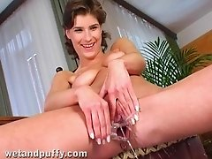 Susane pumps her shaved pussy and drills it with a dildo