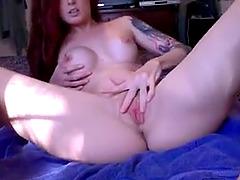 Hot redhead babe masturbating her horny pussy and enjoying