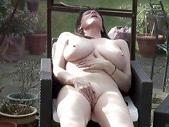 Busty brunette mature buxom amateur Tigger masturbates outdoors