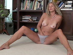 Skinny blonde mature amateur Brenda strips and pinches her nipples