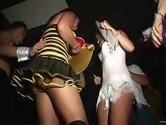 Curvy drunkard cowgirl in miniskirt dancing seductively in the club party