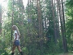 Shaved pussy pissing in the woods