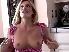 After flashing natural tits lady in high heels Darryl Hanah rubs her wet cunt