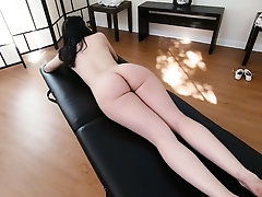 Nice brunette gets her pussy finger fucked and fucked on the massage table