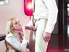 Blond sexy secretary in stockings gets fucked on office table rough