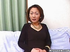 Lewd ardent Japanese MILF in stockings flashes her booty in panties