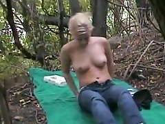 Shy blonde Amber strips and gets fucked missionary style in a forest sex