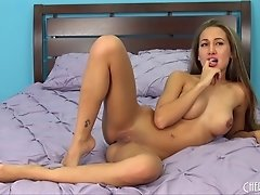 Amia Miley is face down, ass up on the bed using her toy