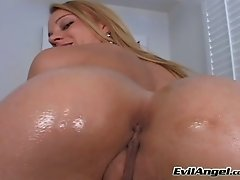 Appetizing blonde in black stockings brags of her rounded smooth bright ass