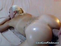 Oiled camslut takes a huge boner up her anal hole