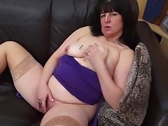 Mature Busty brunette rubs her pussy ahead of toying solo shoot
