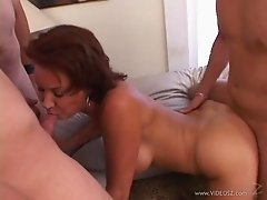 Tempting cowgirl in a sexy thong getting fingered then blowjobs before being gangbanged hardcore