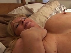 Chubby MILF with big tits Alisha loves fingering her wet twat