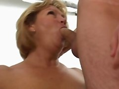 Married MILF goes home with a couple of college dudes