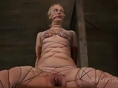 Tied up blonde can't ask for help because of a gag in her mouth hole