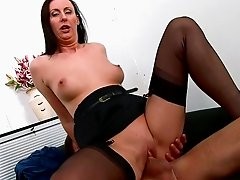 Mommy brunette Lara Latex is sucking a dick
