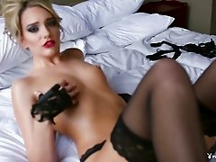 Glamorous solo model in fancy lingerie shows off her bald snatch close up