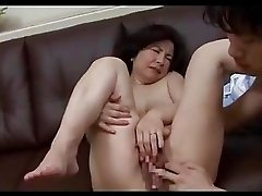 Mature Woman Getting Her Hairy Pussy Fingered By Guy On The Couch In The Sitting Room