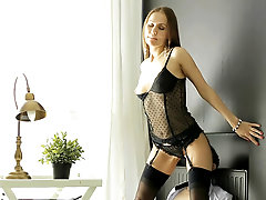 Temptress in black lingerie sits on his face