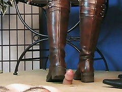 Blindfolded girl crushes cock with boots...